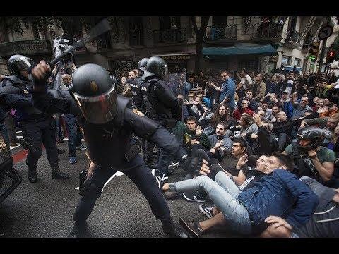 a policeman hitting demonstrators