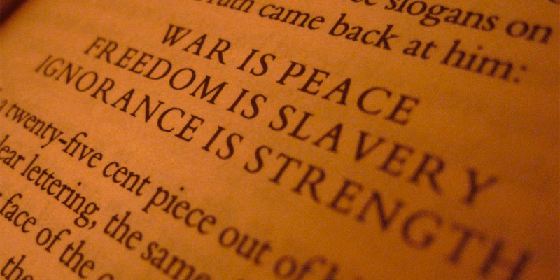the party slogans from Orwell's 1984: war is peace, freedom is slavery, ignorance is strength